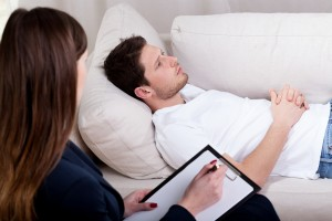 Young therapist working with patient on hypnosis